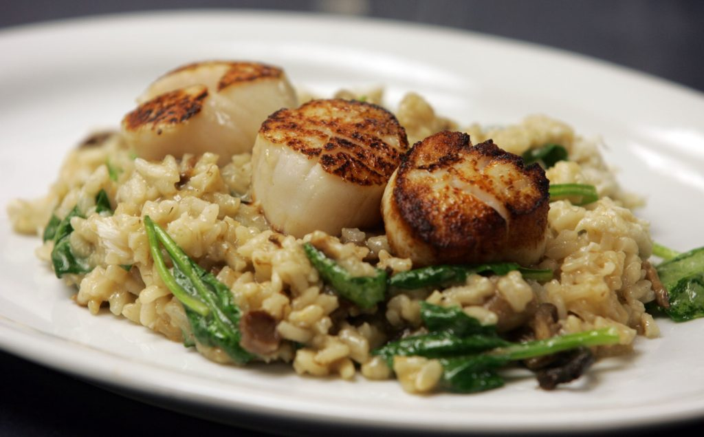LAVALLETTE - 4/1/11 - Day Boat Scallops Risotto Ð with mushroom, spinach and crab is one of the featured dishes at the Ohana Grill at 65 Grand Central Avenue in Lavallette.    OHANAGRILL0401D - ASBURY PARK PRESS PHOTO BY THOMAS P. COSTELLO
